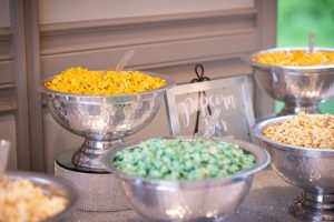 Popcorn bar filled with yellow and green popcorn.